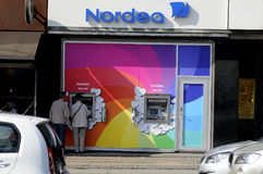 NORDE BANK ATM TURNS RAINBOW COLOURS Stock Image