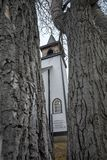 Church behind the birch tree royalty free stock photography