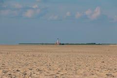 Nordfriesland. Big sandbank in Sankt Peter-Ording in Nordfriesland with Lighthouse Westerhever, Schleswig-Holstein, Germany stock photos