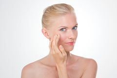 Nordic beauty checking her eye Royalty Free Stock Image