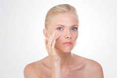 Nordic beauty controls closely her eye Stock Photos