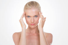 Nordic beauty massaging her head Royalty Free Stock Photo