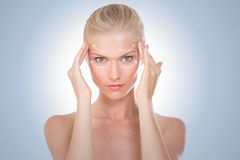 Nordic beauty massaging her temples Royalty Free Stock Photo