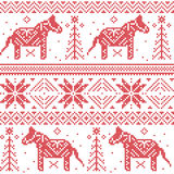 Nordic Christmas pattern with stars, snowflakes, horses in cross stitch Stock Photos