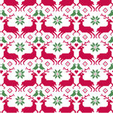 Nordic Christmas seamless pattern with reindeer and birds Royalty Free Stock Images