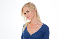 Nordic girl in dark blue shirt with head bent at right Stock Image
