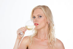 Nordic girl drinking a glass of white wine royalty free stock photos