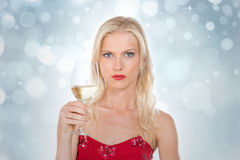 Nordic girl holding a glass of wine on a silver gleaming backgro Stock Photo