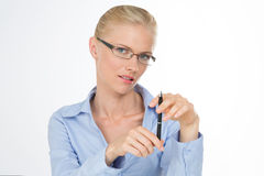Nordic girl with a pen Stock Images