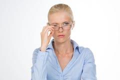 Nordic girl removing her glasses Stock Image