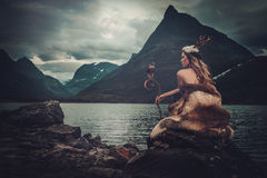 Free Nordic Goddess In Ritual Garment With Hawk Near Wild Mountain Lake In Innerdalen Valley. Royalty Free Stock Photo - 75330415