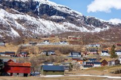 Nordic house in small town with ice cap mountain background Royalty Free Stock Photo