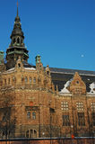 Nordic Museum moon Stockholm. Nordic Museum in Stockholm Sweden with moon in background Royalty Free Stock Photography