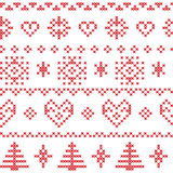 Nordic pattern with snowflakes and Xmas trees and decorative ornaments in red Stock Photos