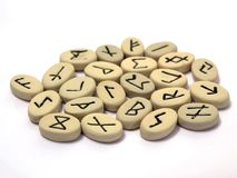 Nordic runes on white background. Fortune telling - nordic runes with symbols on stones Stock Photography