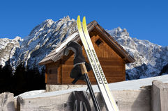 Nordic Skiing - Mountain chalet in winter - Italy. Nordic Skiing in the foreground and Wooden chalet in winter - Alps Italy Royalty Free Stock Photo