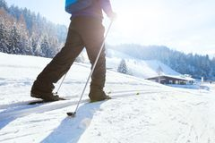 Nordic skiing, winter holidays in Alps, cross country skier. In mountains Stock Images