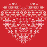 Nordic style Christmas pattern in heart shape with bear on red background. Heart Shape Scandinavian Printed Textile  style and inspired by  Norwegian Christmas Stock Photography
