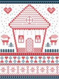Nordic style and inspired by Scandinavian Christmas pattern and craft in cross stitch, in red, blue including  gingerbread house, Royalty Free Stock Photography