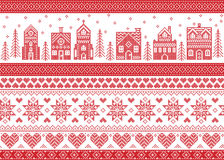 Nordic style and inspired by Scandinavian cross stitch craft merry Christmas pattern in red and white including  winter wonderland. Village, church, Christmas Royalty Free Stock Image