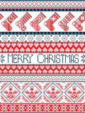 Nordic style Merry Christmas festive winter pattern in cross stitch with stockings ,heart, angel, decorative ornaments, snowflake. In red , white and blue Stock Image
