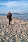 Nordic walker on beach Stock Photography