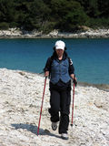 Nordic walker on beach by sea Royalty Free Stock Images