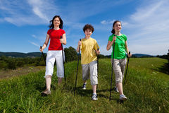 Nordic walkers. Nordic walking - active family outdoor Stock Photography