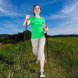 Nordic walkers. Nordic walking - active people outdoor Royalty Free Stock Photo