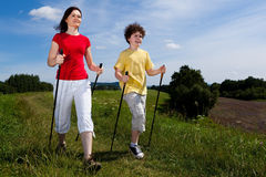 Nordic walkers. Nordic walking - active people outdoor Royalty Free Stock Photography
