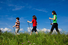 Nordic walkers. Nordic walking - active family outdoor Royalty Free Stock Photo