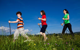 Nordic walkers. Nordic walking - active family outdoor Stock Images
