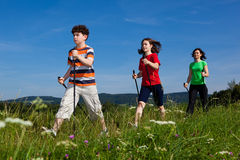 Nordic walkers. Nordic walking - active family outdoor Royalty Free Stock Images