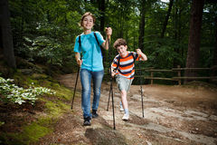 Nordic walkers. Nordic walking - active young people exercising outdoor Royalty Free Stock Photography
