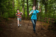Nordic walkers. Nordic walking - active young people exercising outdoor Stock Photo