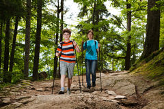 Nordic walkers. Nordic walking - active young people exercising outdoor Royalty Free Stock Images
