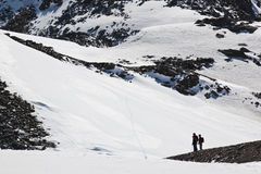 Nordic walkers at Molltaler Glacier, Austria. In the Hohe Tauern National Park 267 formidable mountains which reach over 3, 000 metres  look down kindly on their Stock Photography