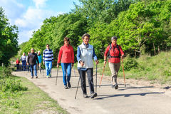 Nordic walkers in natural environment. Kijkduin beach, the Netherlands - May 20, 2017: nordic walkers in a park Stock Photo