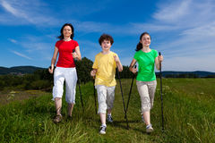Nordic walkers. Nordic walking - active family outdoor Royalty Free Stock Photos