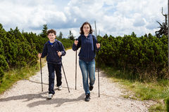 Nordic walkers. Nordic walking - active young people exercising outdoor Royalty Free Stock Photos