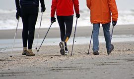 Nordic walking. In the winter on the beach Stock Image