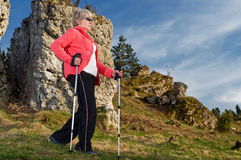 Nordic walking. Senior woman train nordic walking Royalty Free Stock Photos