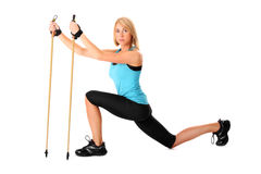 Nordic walking. A picture of a young woman practising nordic walking over white background Stock Photography