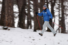 Nordic walking. Woman walking with poles, intentional motion blur royalty free stock photos