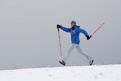 Nordic walking. Woman walking with poles, intentional motion blur stock images