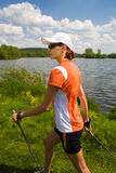 Nordic walking. In summer nature Royalty Free Stock Photo