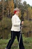 Nordic walking. Senior woman train nordic walking Royalty Free Stock Image