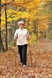 Nordic walking. Senior woman train nordic walking Royalty Free Stock Photography