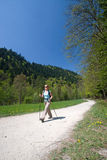 Nordic walking. Young woman is hiking in Pieniny, Slovakia Stock Images