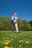 Nordic walking. Young woman is hiking in Slovakia. Beautiful spring day royalty free stock photo
